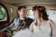 Laura and Jamie's autumn village hall wedding with statement flower crown, emerald green bridesmaid dresses and a squirrel cake topper // Amy Taylor Imaging Photography // The Natural Wedding Company