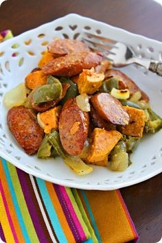 Roasted Sausage, Peppers and Sweet Potatoes- lower fat version [i used a bag of cubed potatoes and added butternut squash instead of sweet potatoes]