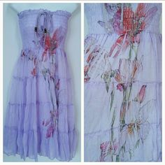 Lovely in Lavender dress NWT Brand new with tags Lovely and lavender tube top dress ties at neckline. Beautiful floral print down the front.   Material is 100% polyester  length of approximately 33 inches.  Bust area is stretchy Size medium Dresses Maxi