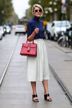 Fashion Week Spring 2015 Street Style. love a pink bag! For more bags visit www.styleontheside.com