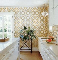 Best idea I've seen today, Tom Scheerer lined the walls of this kitchen with cork floor tiles. Brilliant and oh so beautiful!