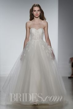 """Brides.com: Our Favorite Lace Wedding Dresses from the Bridal Runways. """"Savannah"""" tulle strapless ball gown with hand appliquéd French lace, Christos  See more Christos wedding dresses."""