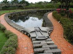 Ju Chun, a renowned Taiwanese sculptor, created this Zipper Lotus Pond for the Juming Museum located just outside Taipei, Taiwan. Very creative way of illustrating the end of a pond! Design Fonte, Art Environnemental, Lotus Pond, Pond Design, Louise Bourgeois, Ponds Backyard, Outdoor Art, Cool Pools, Gardening