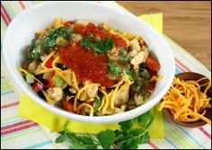 The Southwest Chicken Bowl is full of veggies, beans, and chicken ; loaded with salsa ; topped with full-fat cheese ; doused in a sauce with double-digit fat grams; and served over 400 calories' worth of rice Now you see how a bowl of chicken, veggies, and rice ends up with over 700 calories and nearly 20 grams of fat. Our bowl has 365 cal and only 3 gr of fat
