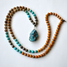 The Holistic Rain Devi Mala. This mala supports the Goddess within - combining a  fierce determination with a gentle nature.  Chrysocolla is the ultimate Goddess stone, devoted to expression, empowerment, and teaching. The turquoise colour induces a feeling of serenity and peace, and discharges negativity. It's the stone of empowerment and feminine energies, expressing genuine power with gentleness and love. Chrysocolla also helps us to nurture our natural spontaneity.