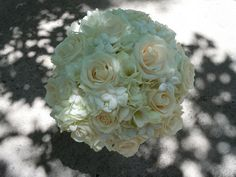 White hydrangea, ivory roses, white freesia and stephanotis with crystal centers Designed by: hillside-consultants.com