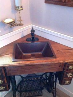 Corner sink made from antique sewing machine cabinet! I wouldn't want to do this to a trettle sewing machine that is all complete, but this would be a darling idea for one missing it's machine! Sewing Machine Tables, Antique Sewing Machines, Sewing Tables, Copper Bathroom, Bathroom Sinks, Bathroom Ideas, Small Bathroom, Small Sink, Remodel Bathroom