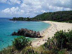 Waimea Bay, Hawaii  This is one of the most beautiful beaches I have seen.  It has fluffy sand.