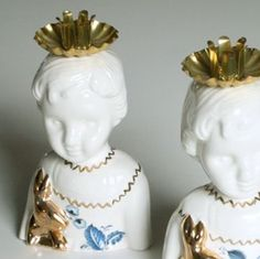 Little candle holders, Clonette dolls by Lammers en Lammers, two Dutch sisters who make traditional Dutch figures in porcelain. From studiodewinkel.nl