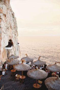 Clifftop tables at Cova d'en Xoroi