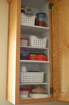 Cupboard shelf stands really maximize the cupboard's storage capacity here.