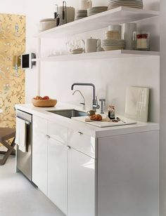 Frustrated with your tiny kitchen? These tips can help you learn to love your small space! There's something special about compact kitchens, especially because they use less energy. For more on tiny kitchen organization, head to Domino! Tiny Dining Rooms, Kitchen Dining, Kitchen Decor, Kitchen Ideas, Kitchen Tile, Ikea Kitchen, Loft Kitchen, Kitchen Board, Mini Kitchen