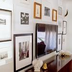 Another example of creating a gallery wall to camouflage the TV