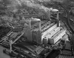 Such a charisma!!  1957: An aerial view of the coal-fired power station on the south bank of the River Thames