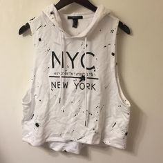 NYC Cut off Cropped Sweatshirt with Hood Soft, cropped, cut off, sweatshirt with a hood! NYC & paint splatter on the front Forever 21 Tops Muscle Tees