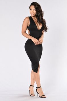 - Available in Black - Long Fitted Dress - Midi Length - Sleeveless - Large Open Key Hole Back - V Neckline - Front Bottom Slit - Made in USA - 67% Rayon 28% Nylon 5% Spandex
