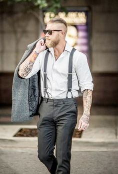 Suspenders, rolled-up sleeves, tats and and a good coat ... Great outfit