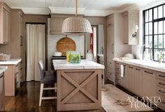 Extra-thick calcutta gold marble counters take this space to the next level.