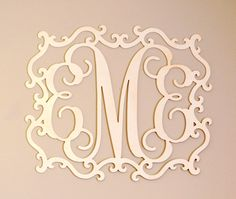 Over bed decor; baby girl nursery monogram - LOTS OF COLORS. This over bed decor monogram will make a wonderful addition to your bedroom decor or a thoughtful gift for that special person or a special occasion. Use it indoors over your bed, over a mirror or above a fireplace or use as a front door wreath to welcome your guests. It also makes the perfect wedding gift for a new couple! Made to order over bed decor in your choice of color on the wood. If three letters, the frame will be...