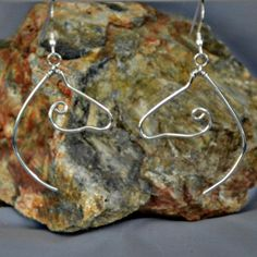 Horsehead earrings of Sterling silver, each one hand formed, are perfect for the horse lover. These all breed horses face each other and sway gently from Sterling silver ear wires. Everyone at the barn will want to know where you got them. They are substantial but light weight. ************** As shown they are just over 2-1/2 inches (65mm) overall in length. They are made one at a time by hand. *************** Comes Gift Boxed 100% satisfaction guaranteed. Love it or return it. Payment by paypal Horse Face, Silver Horse, Wire, Horses, Drop Earrings, Sterling Silver, Handmade, Gifts, Etsy