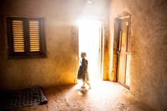 <b>TIME LightBox: William Daniels Wins 2014 Tim Hetherington Grant</b><br>A young girls stands in the doorway of a house. A member of her family, 21 year old Fleuri Doumana, was killed two days earlier by a grenade launched by a member of Seleka. Bangui, Central African Republic. Nov., 2013.