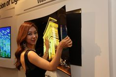 """LG invented a crazy, bendable TV that sticks to your wall like a refrigerator magnet"" -- Just a concept so far..."