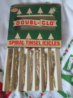 "Vintage Doubl-Glo Spiral Tinsel Icicles in Box-Paper Novelty Co. New York  There are 7 icicles here and they are in the original box. They are about 4-5"" in length."