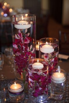 centerpieces orchids A Purple Romantic Wedding at Aliso Viejo Country Club in Aliso Viejo, California Christmas Wedding Centerpieces, J Birds, Candle Arrangements, Aliso Viejo, Cymbidium Orchids, Floating Candles, Centre Pieces, Burgundy Wedding, Beautiful Christmas