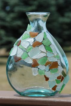 Beach glass bottle.....this would look really cute once covered with seaglass and string of white lights inside.