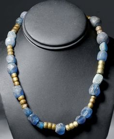Viking Glass Bead Necklace, Century AD This is made of two kinds of glass beads and was meant to be worn by a Viking woman. The smaller beads appear to be Norse-made copies of Islamic glass beads that were blown around gold Medieval Jewelry, Viking Jewelry, Ancient Jewelry, Antique Jewelry, Beaded Jewelry, Beaded Necklace, Jewellery, Necklaces, Iron Age
