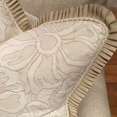 Custom pillow trimmed using pleated French Grosgrain trim from Samuel and Sons.