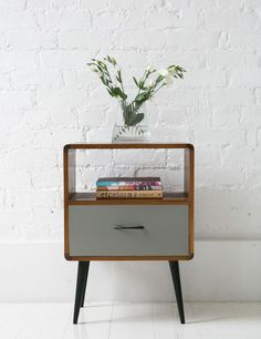 Mid Century Bedside Cabinet with a reassuringly nostalgic feel, with neat tapering legs, pale wood, and contrasting putty coloured drawer