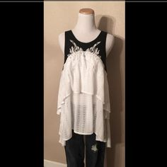 """FREE PEOPLE TOP Beautiful high-low top with lovely embroidery. The lace up back is super unique, as is the large back peek-a-boo. The cotton and leather are a great combination. Back is 39"""" from shoulder to hem, the front is 29"""" from shoulder to hem. NWOT This top is a large but can be worn by several sizes. Free People Tops"""