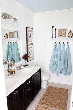 Coastal style bath; love the blue ceiling hook, towel racks, blue, white walls, black cabinets, coastal style, guest bath, painted ceilings, bathroom cabinets