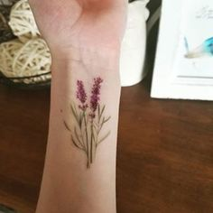 These dainty lavender branches. | 22 Impossibly Beautiful Floral Tattoos