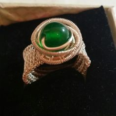 Wire woven ring with emerald glass bead