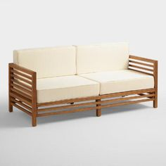 The bold beauty of our contemporary occasional bench comes from solid acacia wood construction highlighted with a natural finish. With comfy cushions, its deep seat and chunky, slatted profile are ideal for resort-style lounging.