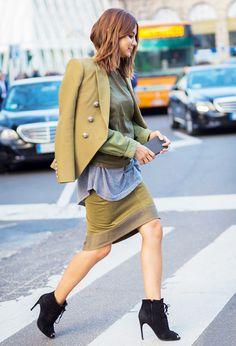 Christine Centenera goes for a bold olive green look and chic lace-up ankle boots