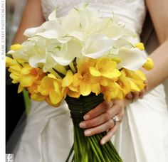 calla lily bouquet with a collar of yellow freesia.