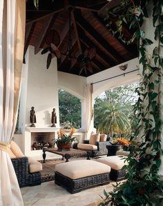 Gazebo - black rattan furniture with cream cushions create a nice outdoor living room - beautiful fireplace and ceiling | B. Pila Design Studio