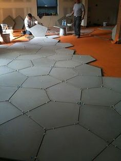 loving concrete floor tiles for basement- wonder if they can be heated -nice tiles huh? But only for basement.