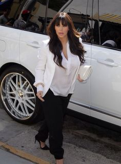 Kim arriving at Bel Bambini in Hollywood earlier this 2013 Paired a Chloe blazer with a pea in the pod white blouse, Kardashian Kollection pants and Jean Michael Cazabat heels
