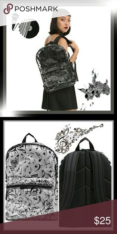"CLEAR MUSIC NOTE PRINT BACKPACK You're transparent when it comes to your passion for music. Why not make it more clear? This see-through backpack features an allover music note print and a padded black back. It's perfect for showing off all those band stickers on your notebooks! Adjustable padded straps, zipper compartment, front zipper pocket, and side water bottle pocket.  100% PVC 17"" x 12 1/2"" Moon Goddess Boutique Bags"