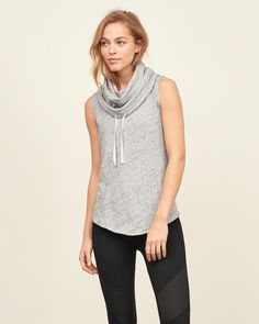 Lightweight and comfortable with a drawstring funnel neck, front pocket and side split detail, Imported
