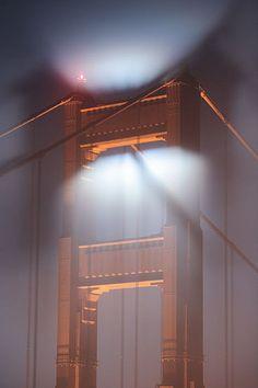 Shadow of the Golden Gate Bridge in fog, San Francisco, California.