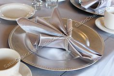 """Rent silver plate chargers and silver satin napkins and """"diamonds"""" icy napkin rings - SatinChairCovers.com"""