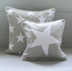 Applique star cushion in linen and white