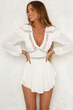 We love our Fluid Feelings Playsuit and we're sure you'll love it too. This romantic style has a V neckline, invisible back zip and crochet panels along the bodice. It also has ruffle details on the shoulders, long sleeves that gather at the wrist and an Sexy Outfits, Trendy Outfits, Summer Outfits, Cute Outfits, Summer Dresses, Cute Dresses, Casual Dresses, Short Dresses, Fashion Dresses