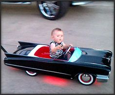 Custom Cadillac Baby Stroller/Push Car from Todd Rodz. I'm not sure about the flames that shoot out of the back, but what kid wouldn't love riding in this. There is also a video of it on YouTube.
