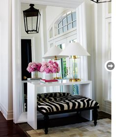 Love this Mix and Chic feature, this home is in Muskoka! I love the reflection of the lighting used, the zebra print ottoman is gorgeous on the beige self print rug. I am a sucker for anything Chanel with a vase of peonies! Simply stunning!!